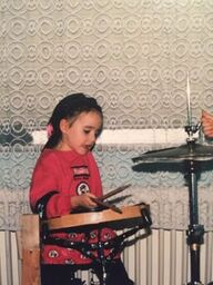 Charlotte was always interested in drums.